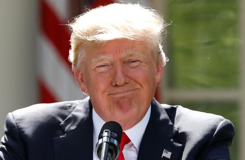 US President Donald Trump pauses as he announces his decision that the United States will withdraw from the landmark Paris Climate Agreement, in the Rose Garden of the White House in Washington, US, June 1, 2017. (photo credit: KEVIN LAMARQUE/REUTERS)