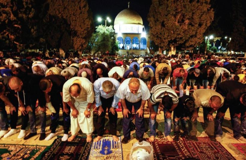 WORSHIPERS PERFORM Taraweeh prayers at al-Aksa Mosque in Jerusalem's Old City earlier this week. (photo credit: SLIMAN KHADER/FLASH90)