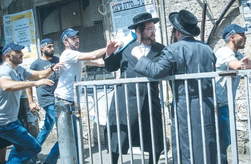 ULTRA-ORTHODOX MEN clash with police in the capital's Mea She'arim neighborhood yesterday. (photo credit: YONATAN SINDEL/FLASH 90)