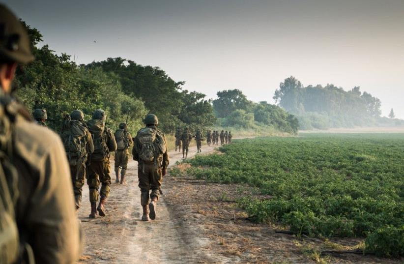 IDF SOLDIERS take part in a military exercise. (photo credit: IDF SPOKESMAN'S UNIT)