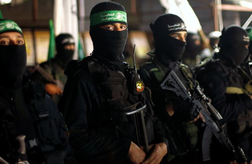 Palestinian Hamas militants take part in a memorial service for senior militant Mazen Fuqaha, in Gaza City March 27, 2017. (photo credit: REUTERS/MOHAMMED SALEM)