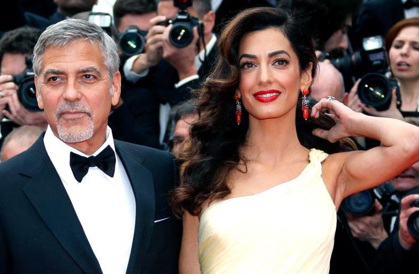 George and Amal Clooney at the 69th Cannes Film Festival in Cannes, France in 2016 (photo credit: REUTERS)