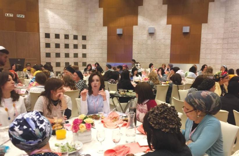 ULTRA-ORTHODOX WOMEN network at the Jerusalem International Convention Center yesterday (photo credit: TEMECH)