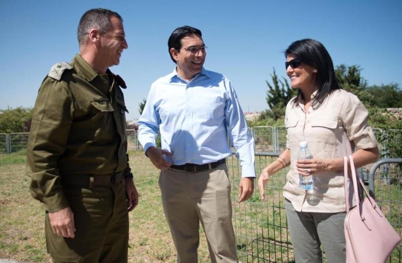 US Ambassador to the UN Nikki Haley in Israeli with Israel's Ambassador to the UN Danny Dannon and IDF Maj.-Gen. Aviv Kochavi (photo credit: IDF SPOKESMAN'S UNIT)