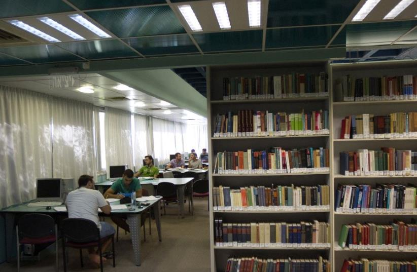 Students sit in a library at the Ariel University Center in the West Bank settlement of Ariel (photo credit: REUTERS/Ronen Zvulun)