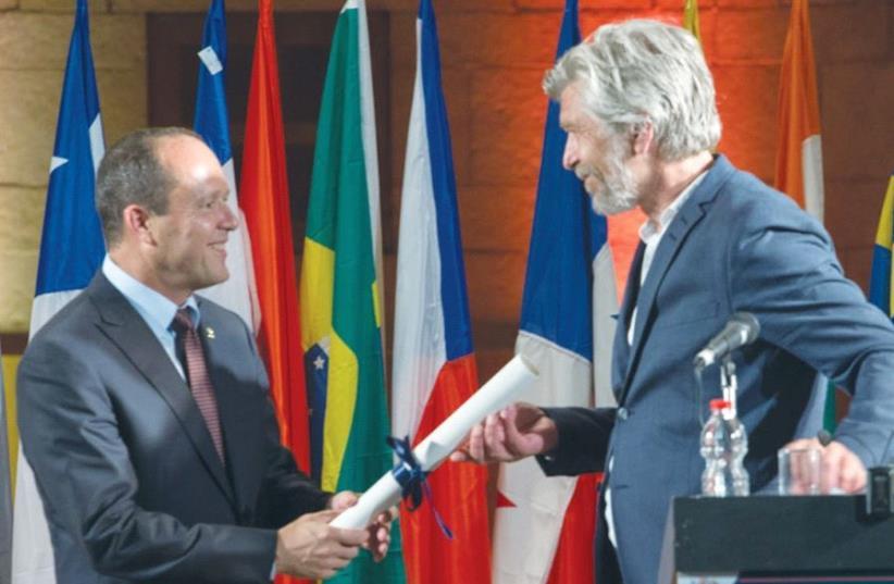 JERUSALEM MAYOR NIR BARKAT awards Norwegian author Karl Ove Knausgård the 2017 Jerusalem Prize. (photo credit: DAVID SAAD)