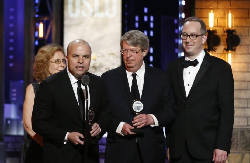 """J.T. Rogers (L) accepts Best Play for """"Oslo"""" at the 71st Tony Awards, June 11 2017. (photo credit: REUTERS/CARLO ALLEGRI)"""