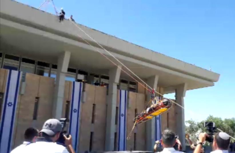 Emergency rescue teams practice evacuating the Knesset as part of earthquake drill. (photo credit: GIL HOFFMAN)