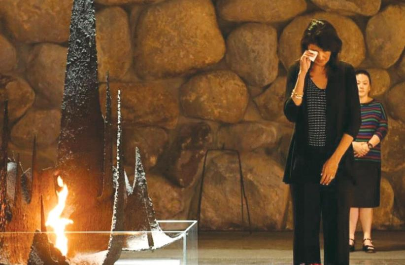 US AMBASSADOR to the UN Nikki Haley wipes a tear after laying a wreath at the Yad Vashem Hall of Remembrance last week (photo credit: Courtesy)