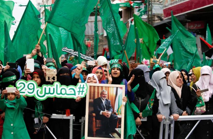 Palestinian Hamas supporters shout slogans during a rally marking the 29th anniversary of the founding of the Hamas movement, in Gaza city December 14, 2016 (photo credit: SUHAIB SALEM / REUTERS)