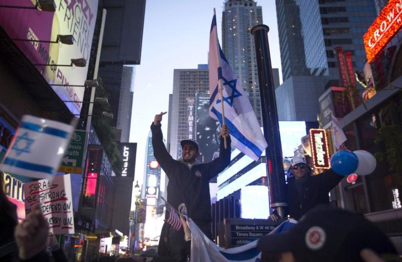 Pro-Israel demonstrators chant slogans in New York City in 2015. One segment of American Jewry that has drawn closer to Israel these past 50 years is the 10% who are Orthodox (photo credit: REUTERS)