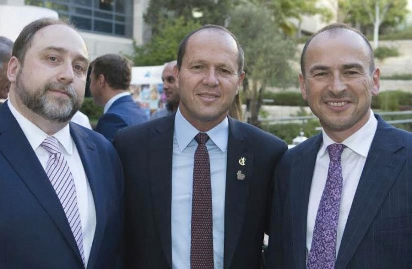 JERUSALEM MAYOR Nir Barkat is flanked by Ilia Salita (left) and Gennady Gazin at the opening of the new Genesis office in the capital's Har Hotzvim. (photo credit: Courtesy)