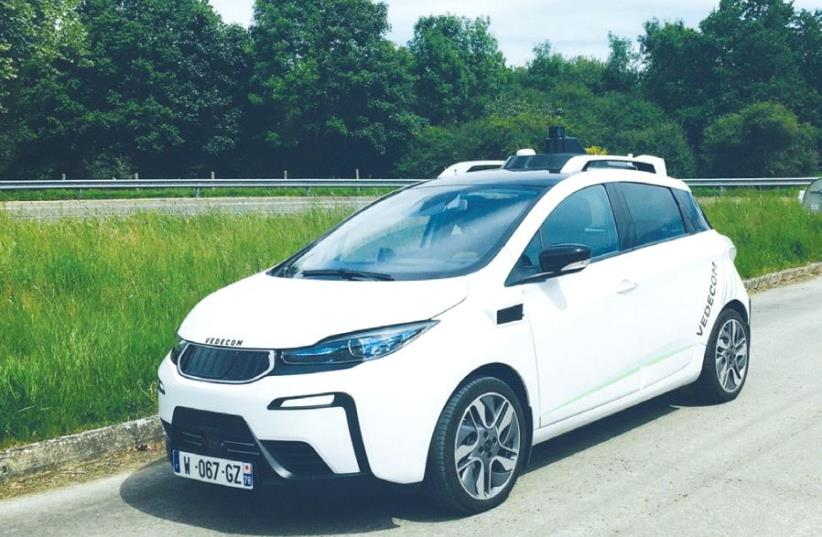 VEDECOM'S AUTONOMOUS VEHICLE is designed to detect ground markings, recognize signs and adjust speed according to traffic signals, road obstacles and other vehicles. (photo credit: VEDECOM)