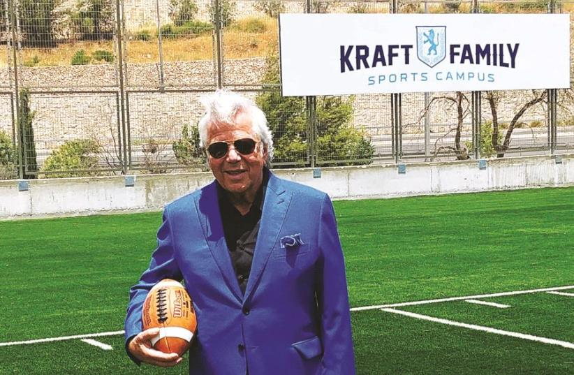 Robert Kraft poses on the 30-yard-line of the regulation-size football field at the newly inaugurated Kraft Family Sports Campus in Jerusalem. The New England Patriots owner wrapped up his star-studded Touchdown Israel II trip yesterday. (photo credit: URIEL STURM)
