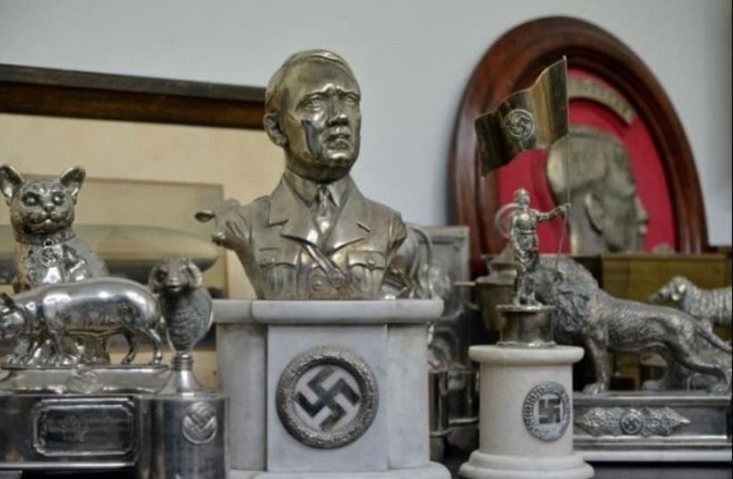 A bust of dictator Adolf Hitler, among other Nazi artifacts seized in the house of an art collector, is on display in Buenos Aires, in this undated handout released on June 20, 2017.  (photo credit: ARGENTINE MINISTRY OF SECURITY/HANDOUT VIA REUTERS)