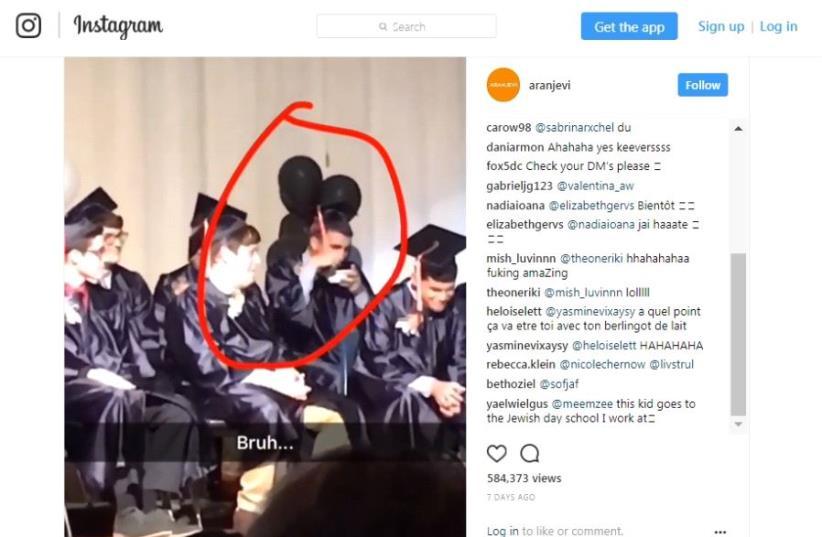 Jewish high school graduate's prank at graduation ceremony goes viral  (photo credit: screenshot)
