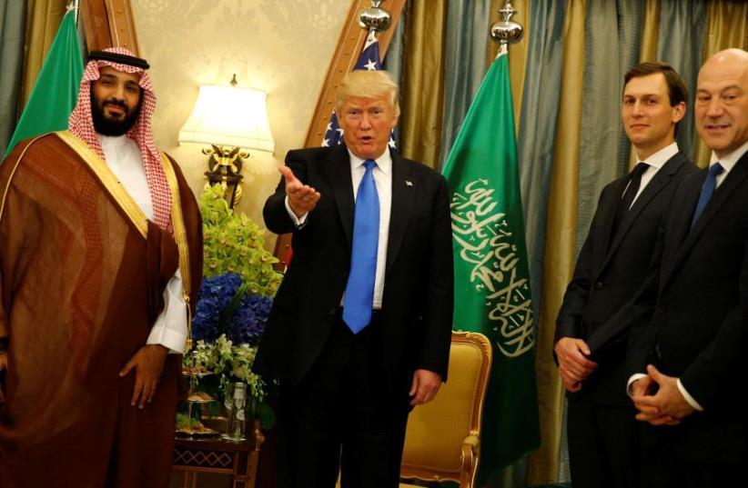 US President Donald Trump, flanked by White House senior advisor Jared Kushner and Saudi Arabia's Deputy Crown Prince and Minister of Defense Mohammed bin Salman at the Ritz Carlton Hotel in Riyadh, Saudi Arabia  (photo credit: JONATHAN ERNST / REUTERS)