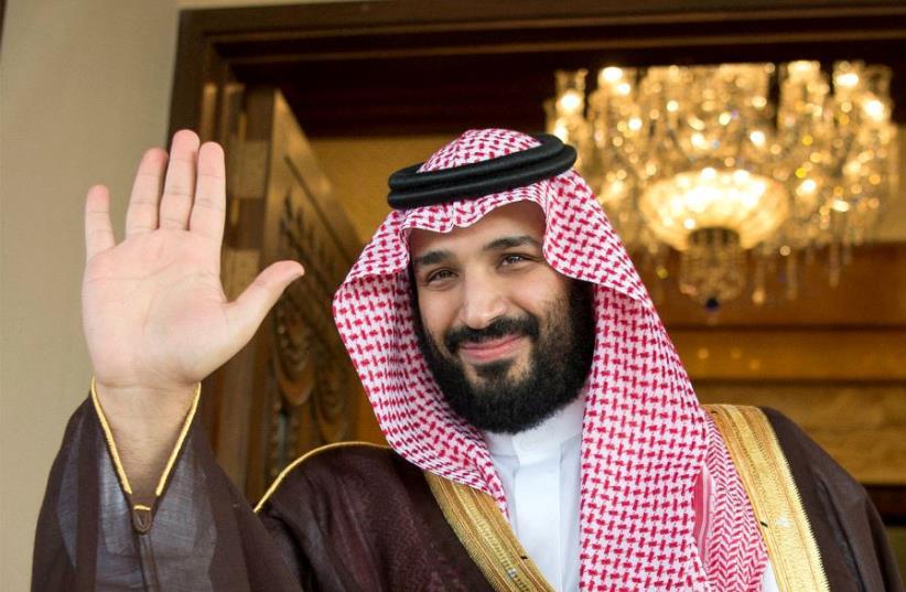 Saudi Deputy Crown Prince Mohammed bin Salman waves (photo credit: BANDAR ALGALOUD/COURTESY OF SAUDI ROYAL COURT/REUTERS)