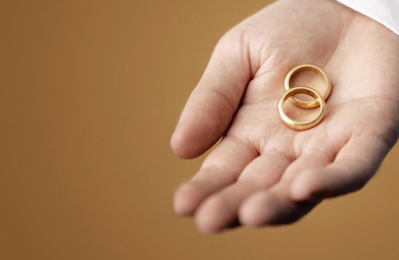 Wedding rings [Illustrative] (photo credit: ING IMAGE/ASAP)