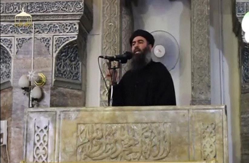 Al-Baghdadi proclaimed himself 'caliph,' or ruler of all Muslims, from the pulpit of the al-Nuri Mosque on July 4, 2014 (photo credit: REUTERS/SOCIAL MEDIA WEBSITE VIA REUTERS TV)