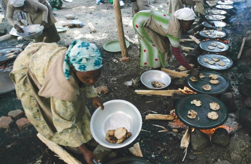 women prepare matza ahead of Passover in Gondor in 2007 (photo credit: REUTERS)