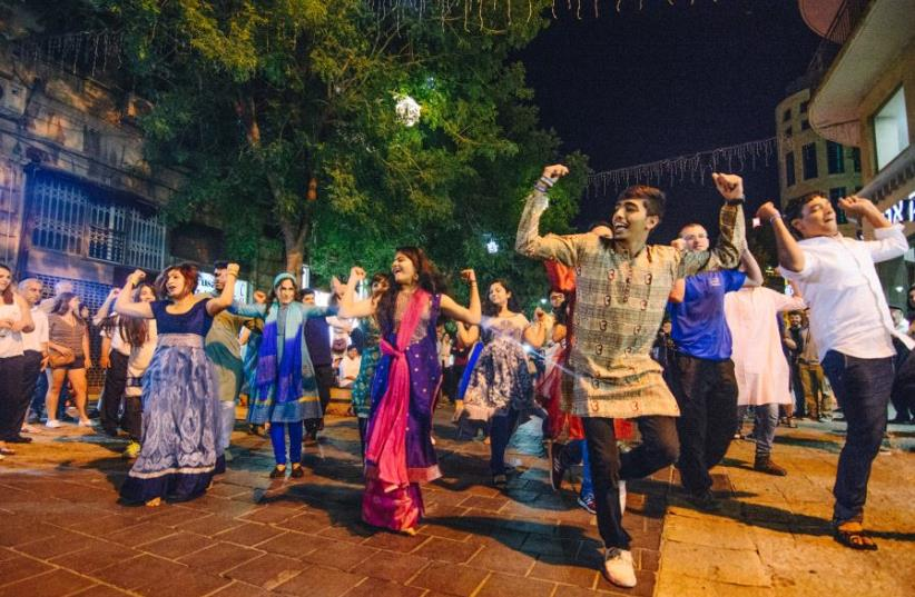 Leora Ruben, Mayan Sanlar, Avishai Mazgaonkar and Oved Gadkar bring a little Bollywood to Jerusalem as part of their Birthright trip from India. (photo credit: ISRAEL EXPERIENCE)