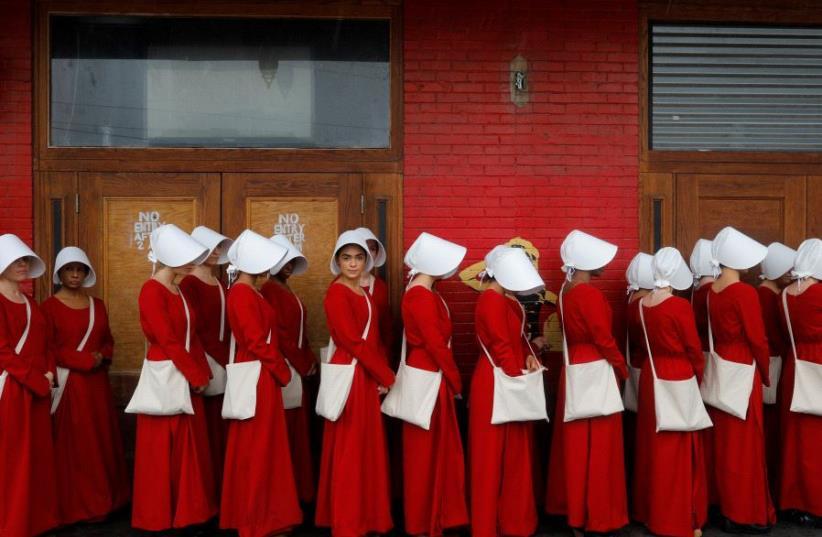 "Women dressed as handmaids promoting the Hulu original series ""The Handmaid's Tale"" in Texas. (photo credit: BRIAN SNYDER / REUTERS)"