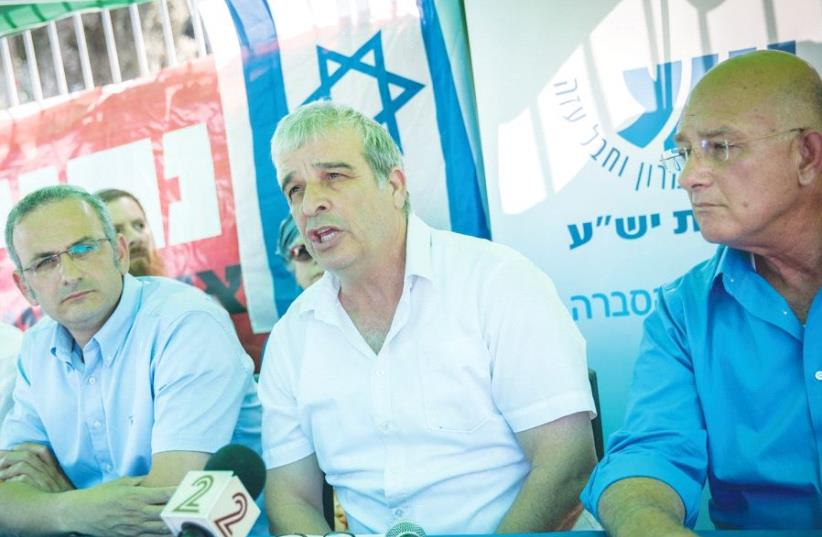 YESHA COUNCIL HEAD Avi Ro'eh speaks during a press conference at the protest tent of Beit El residents in Jerusalem yesterday. (photo credit: YONATAN SINDEL/FLASH 90)