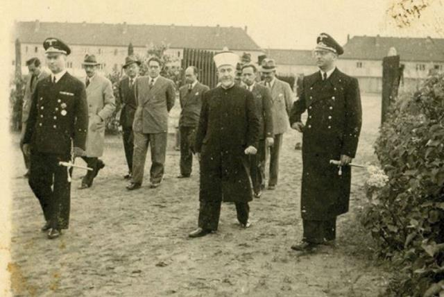 Haj Amin al-Husseini pictured visiting an unnamed German camp during World War II.  (photo credit: KEDEM AUCTION HOUSE)