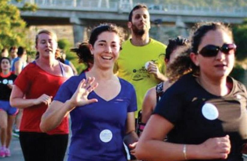 MEMBERS OF Runners Without Borders participate in a race in east Jerusalem in March (photo credit: Courtesy)