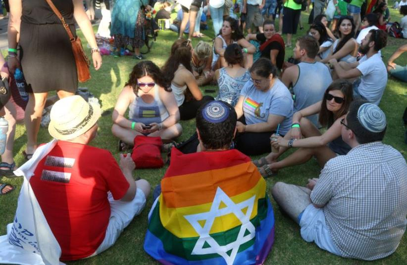 Participants at Jerusalem Pride Parade, 2016  (photo credit: MARC ISRAEL SELLEM/THE JERUSALEM POST)