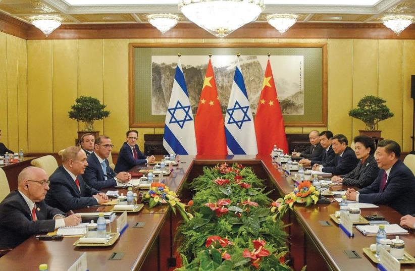 Prime Minister Benjamin Netanyahu meets with Chinese President Xi Jinping in Beijing on March 21 (photo credit: REUTERS)