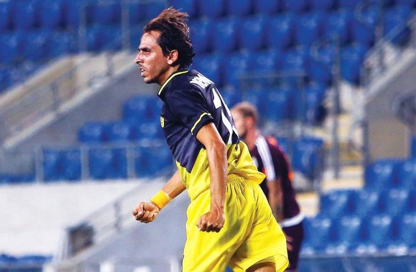 Beitar Jerusalem midfielder Yossi Benayoun celebrates after scoring on his debut last night, sparking the side to a 4-3 comeback win over Vasas of Hungary in Europa League qualifying in Petah Tikva (photo credit: UDI ZITIAT)