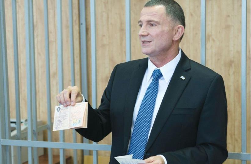 KNESSET SPEAKER Yuli Eldelstein holds his birth certificate and a union membership card, which were seized from him when he was jailed as a Prisoner of Zion 33 years ago (photo credit: ISRAELI EMBASSY MOSCOW)