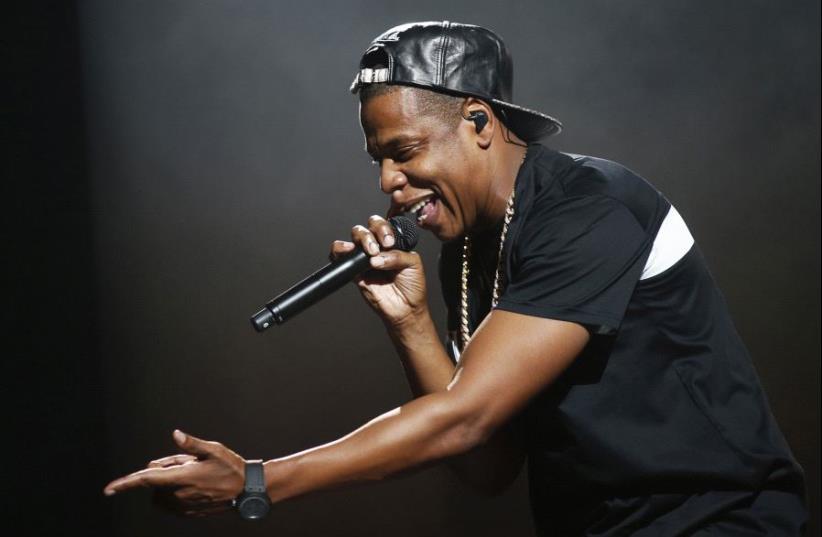 American rapper Jay-Z performs at Bercy stadium in Paris, October 17, 2013. (photo credit: BENOIT TESSIER /REUTERS)
