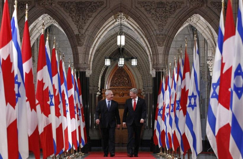 Canada's Prime Minister Stephen Harper (R) walks down the Hall of Honour with Israel's Prime Minister Benjamin Netanyahu on Parliament Hill in Ottawa March 2, 2012.  (photo credit: REUTERS/CHRIS WATTIE)
