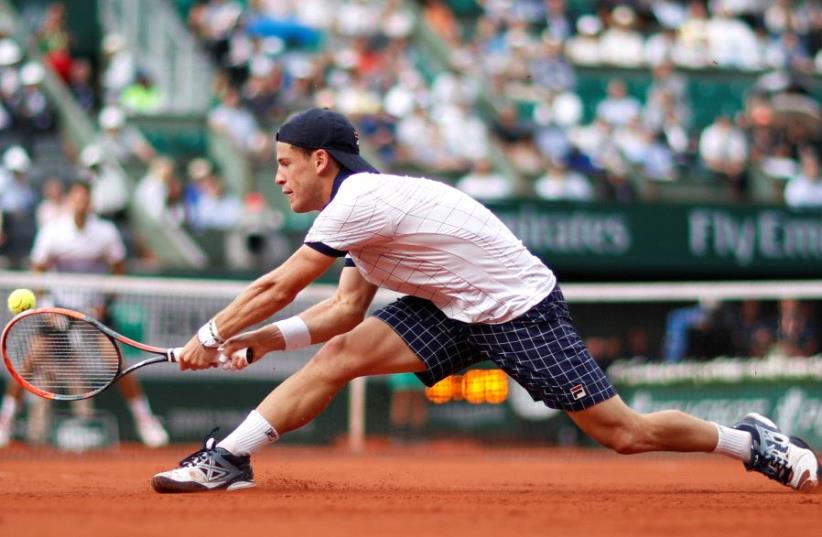 Argentina's Diego Schwartzman in action during his French Open third round match against Serbia's Novak Djokovic, June 2, 2017. (photo credit: REUTERS / CHRISTIAN HARTMANN)