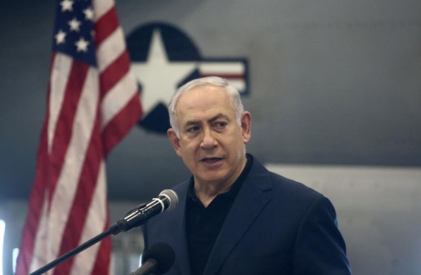 Prime Minister Benjamin Netanyahu aboard the USS George H.W. Bush docked in northern Israel's Haifa Port, July 3, 2017 (photo credit: MARC ISRAEL SELLEM/THE JERUSALEM POST)