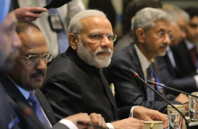Indian Prime Minister Modi and delegation participates in meeting at the White House in Washington (photo credit: REUTERS/CARLOS BARRIA)