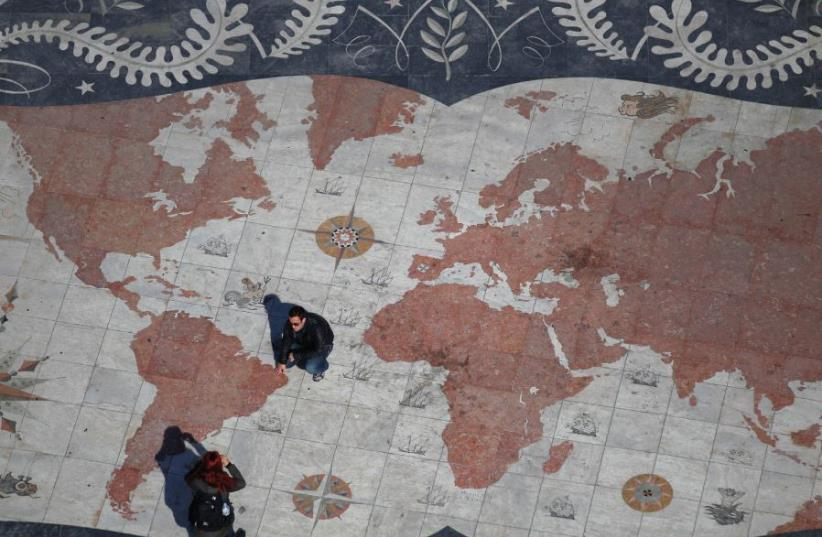 A tile design with the map of the world (photo credit: REUTERS)