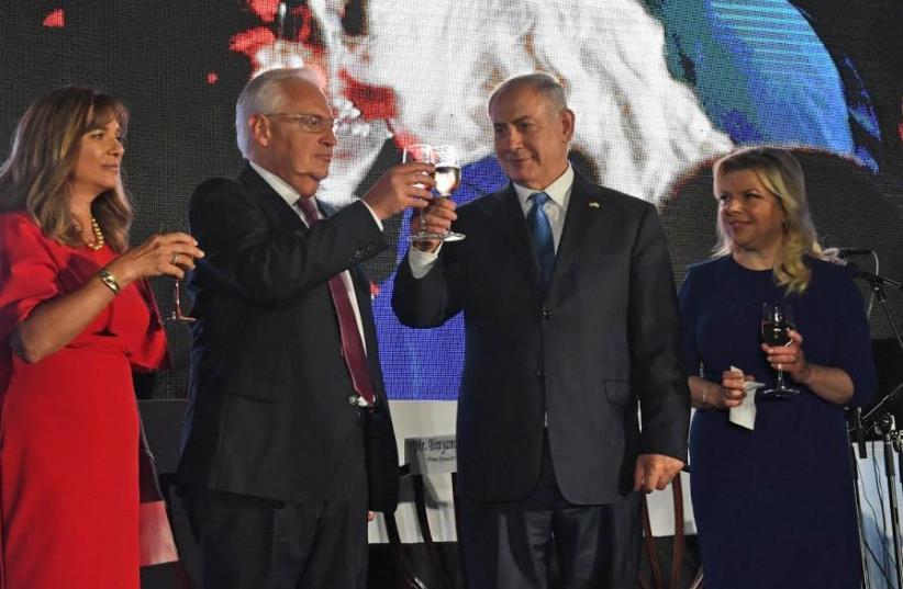 Prime Minister Benjamin Netanyahu and US Ambassador to Israel David Friedman at the July 4 celebration at the US Embassy in Tel Aviv (photo credit: KOBI GIDEON/GPO)