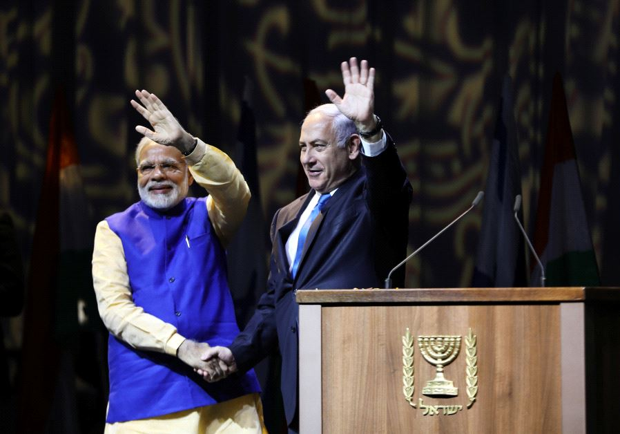 Indian Prime Minister Narendra Modi (L) and Israeli Prime Minister Benjamin Netanyahu shake hands as they wave to the crowd during a reception for the Indian community in Israel, in Tel Aviv, Israel July 5, 2017.