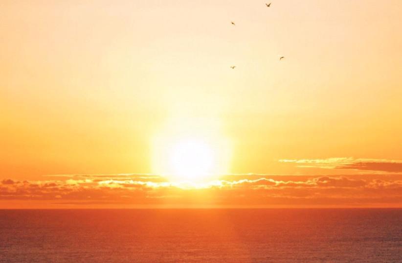 Sea at sunset (photo credit: Wikimedia Commons)