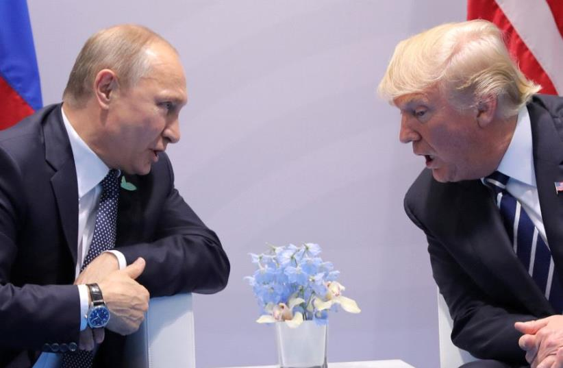 U.S. President Donald Trump speaks with Russian President Vladimir Putin during the their bilateral meeting at the G20 summit in Hamburg, Germany July 7, 2017. (photo credit: REUTERS/CARLOS BARRIA)