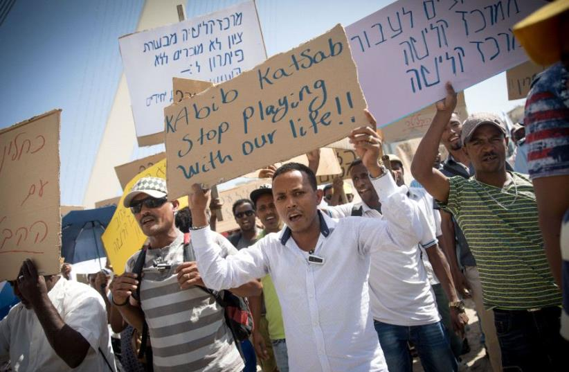 Ethiopian immigrants protest in the Israeli capital against the looming evacuation of their absorption center in the Jerusalem suburb of Mevasseret Zion, July 10, 2017. (photo credit: MARC ISRAEL SELLEM/THE JERUSALEM POST)