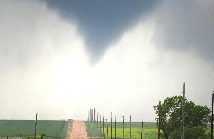 A TORNADO forms over the fields of Kansas. (photo credit: REUTERS)