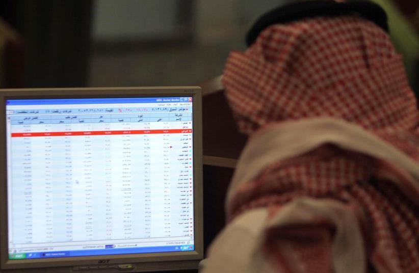 A Saudi man sits at a computer [File] (photo credit: REUTERS)