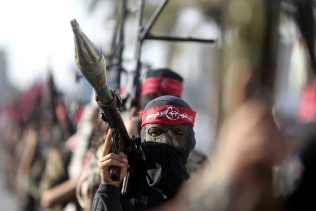 Palestinian members of the Popular Front for the Liberation of Palestine (PFLP) take part in a military show in Gaza  (photo credit: REUTERS)