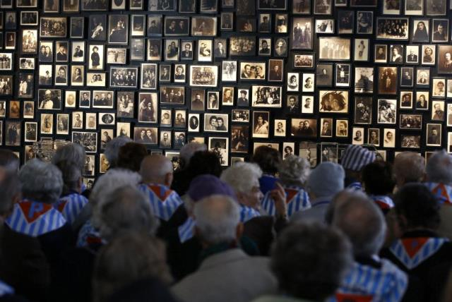 Survivors attend a ceremony in the former Nazi German concentration and extermination camp Auschwitz-Birkenau in Oswiecim, Poland January 27, 2016, to mark the 71st anniversary of the liberation of the camp by Soviet troops and to remember the victims of the Holocaust (photo credit: REUTERS)