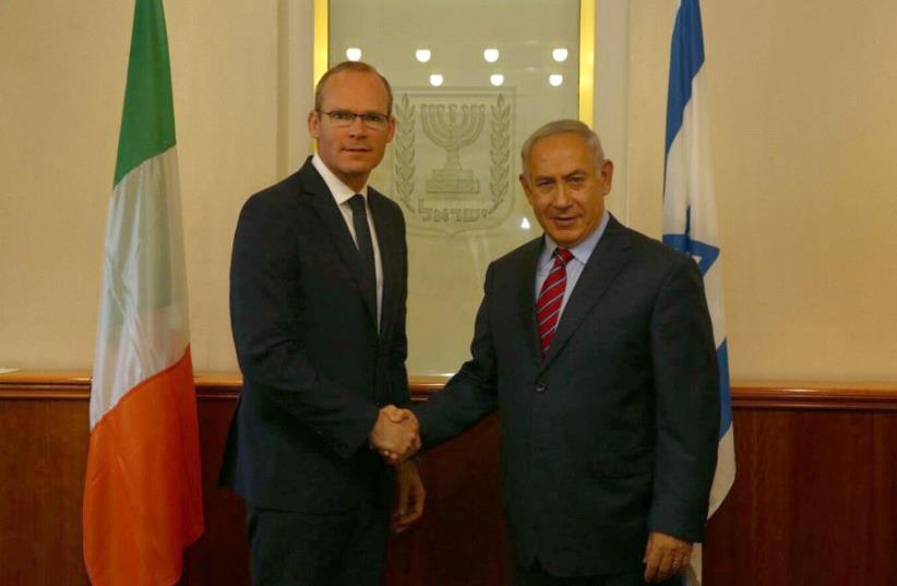 Netanyahu and Irish FM Simon Coveney (photo credit: CHAIM ZACH / GPO)